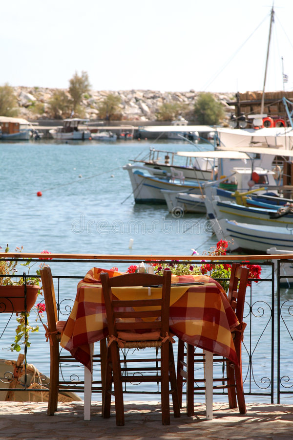 Little greek restaurant by the harbour royalty free stock photo