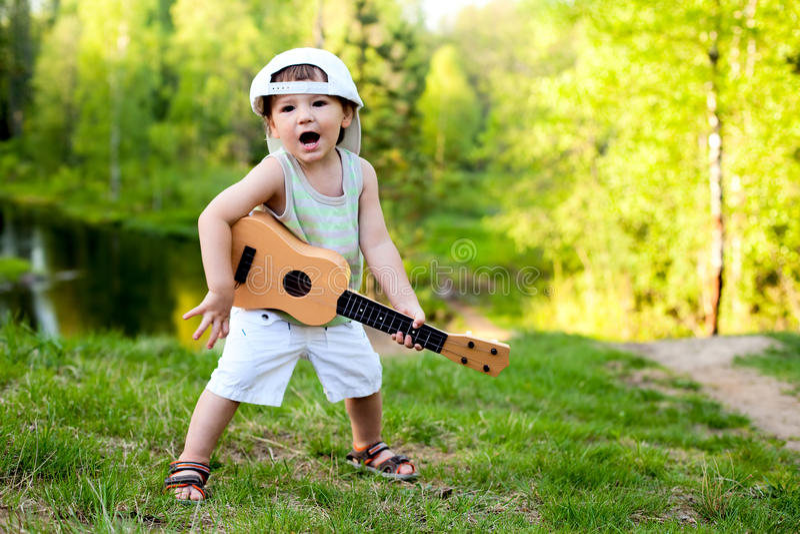 Little guitarist stock images