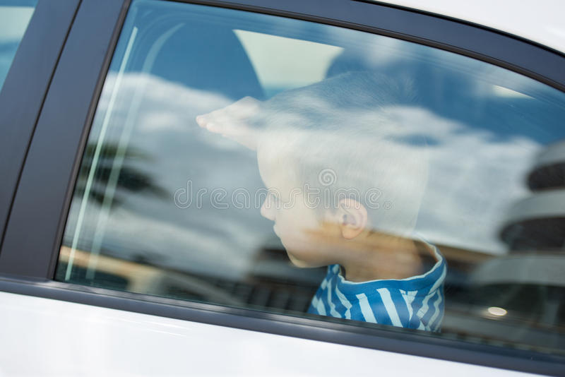 Little guy in car stock photography