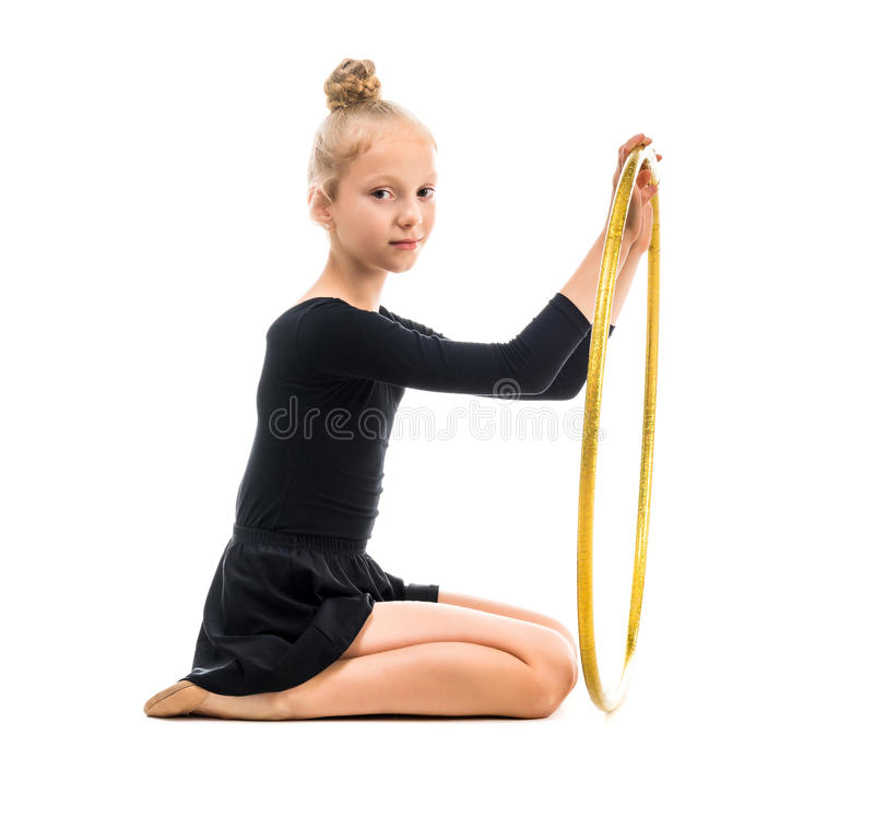 Little gymnast doing exercise with hoop. Isolated on white background stock photography