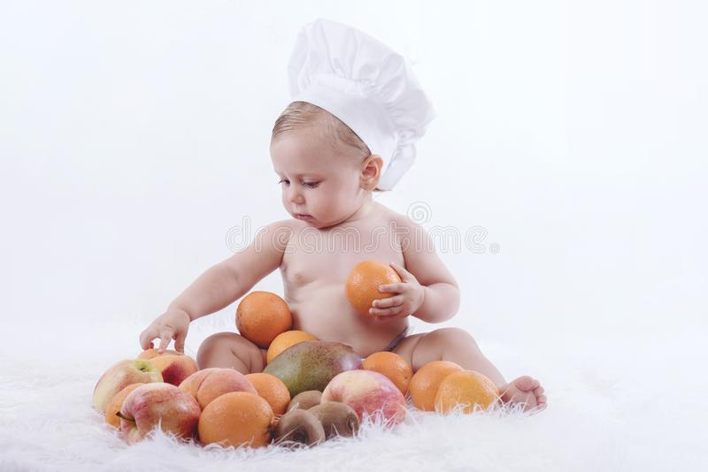 Baby with fruits stock photography