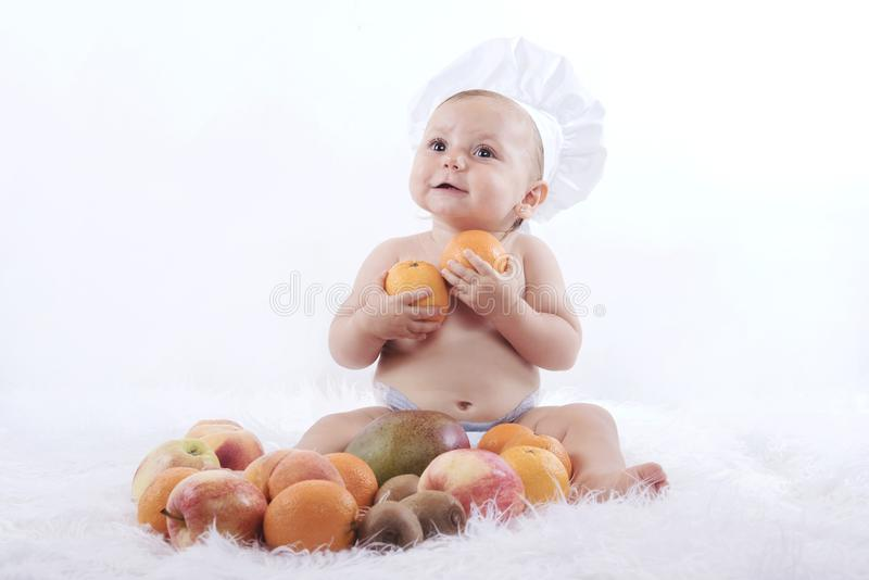 Baby with fruits royalty free stock images