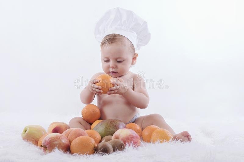 Baby with fruits royalty free stock photography