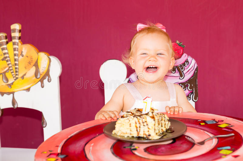 Little happy baby girl celebrating first birthday. Kid and her first cake on party. Childhood. royalty free stock photos