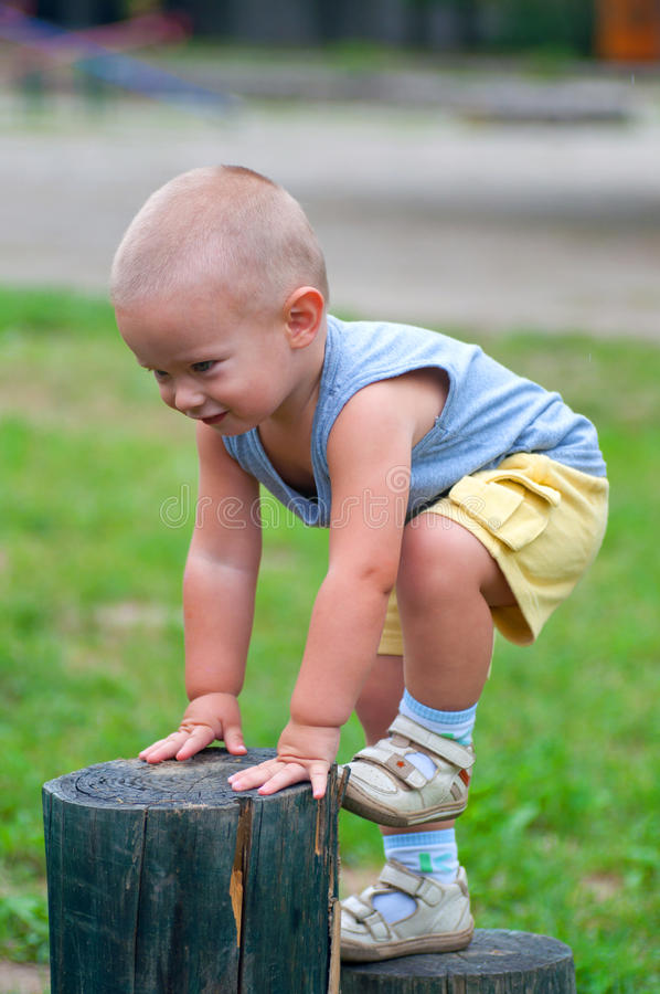 Download Little happy boy climbing stock photo. Image of active - 20598634