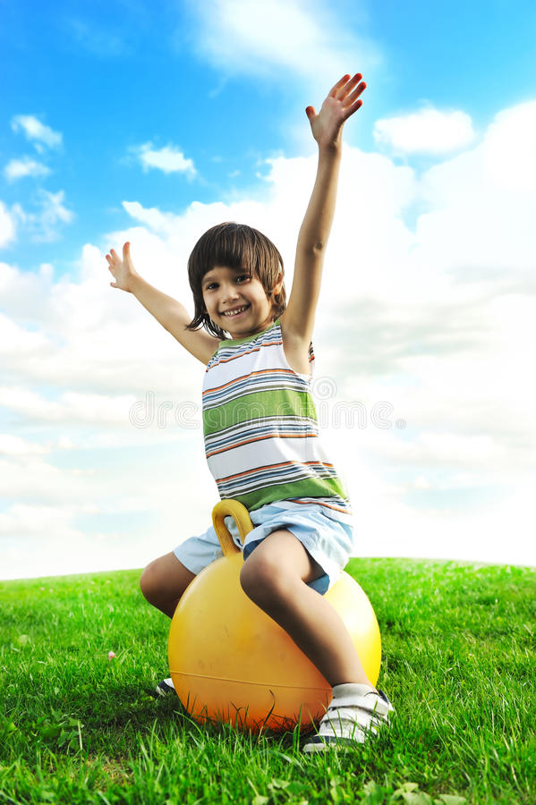 Little happy boy playing with big ball royalty free stock photography