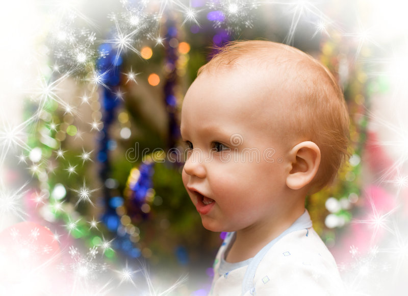 Little happy boy under christmas tree royalty free stock photography