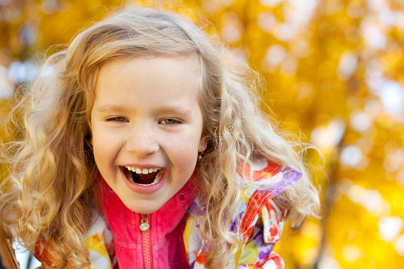 Girl in autumn park stock images