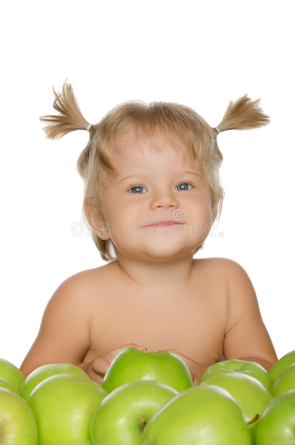 Little happy girl with green apples royalty free stock photos