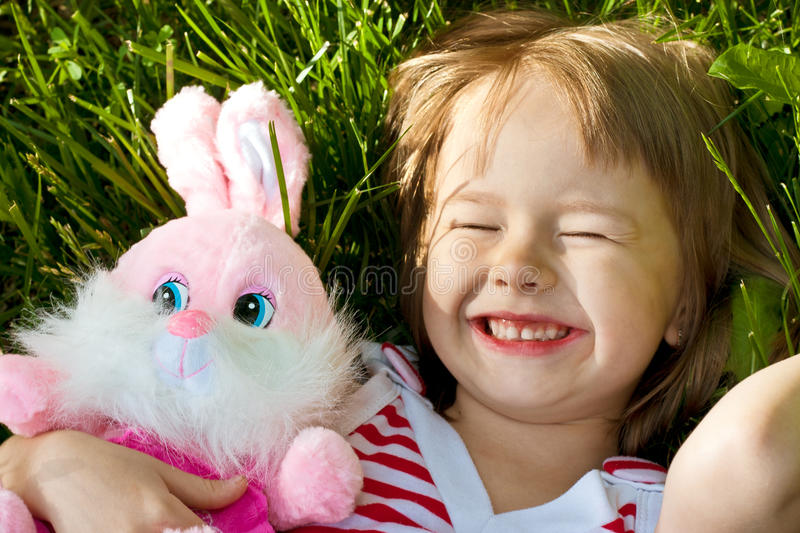 Little Happy Girl Lies In Grass Stock Photography