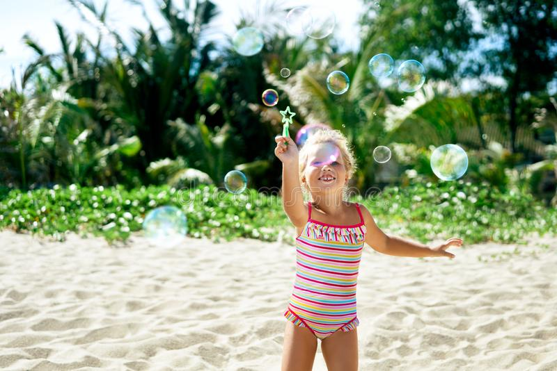 Happy Little Girl Playing With Bubbles Stock Photo
