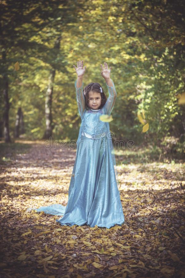 Little fashionable girl. Little and happy girl playing in the woods,selective focus stock photography