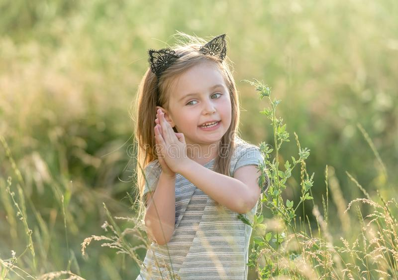 Little happy girl at sunset stock image