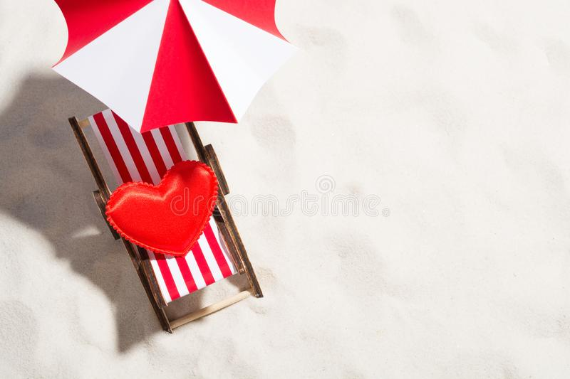 Little heart and for relaxing on the beach. Little heart and chair for relaxing on the beach royalty free stock images