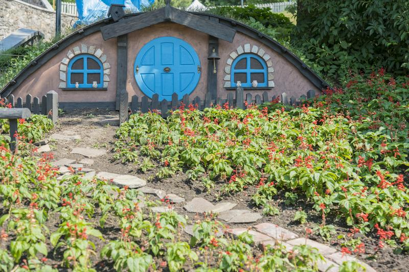 The little hobbit house. Themed flowerbed in the park.  stock image