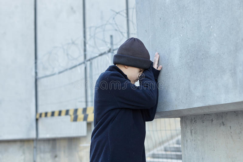 Little homeless boy on the street. Poverty, city royalty free stock images