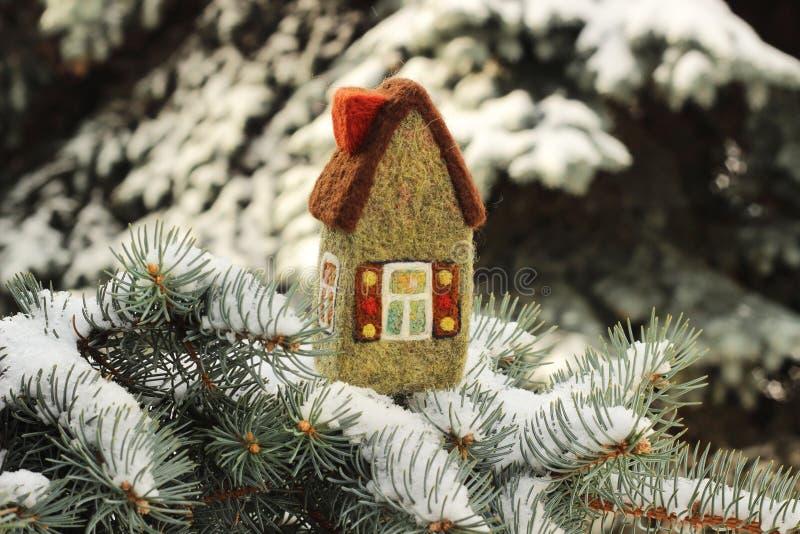 Little house on fir tree stock image