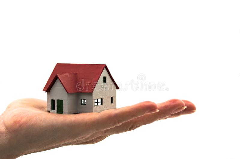 A little house in the hand of a woman. An image of a hand with a red roof house with blank background. Isolated, household, mansion, businessman, sell, ideas stock photos