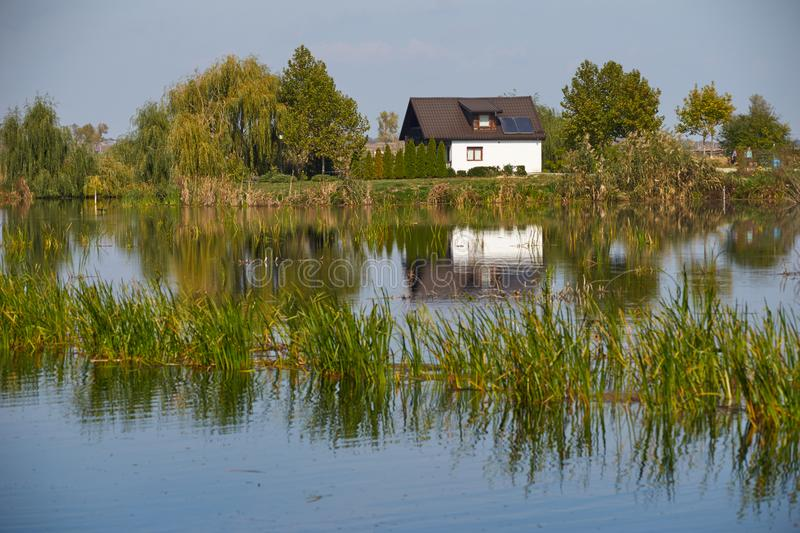 Little house reflection. In natural park Comana Romania royalty free stock photos