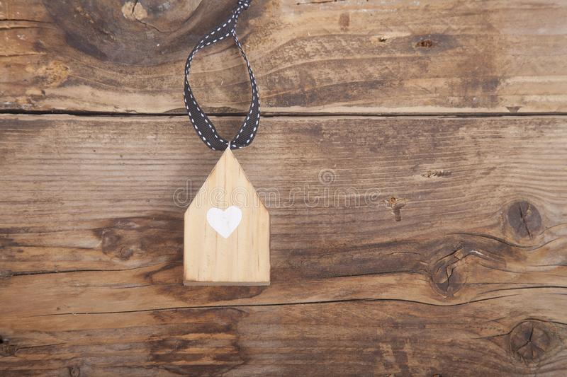 Little house on wooden background royalty free stock photo