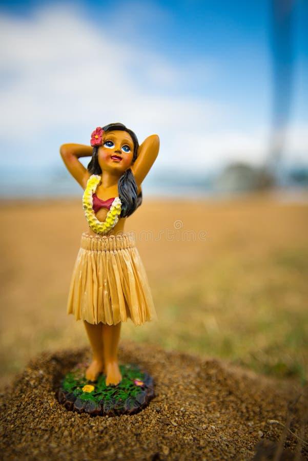 Little hula dancer figure in the sand. Little hula dancer figure at the beach stock image