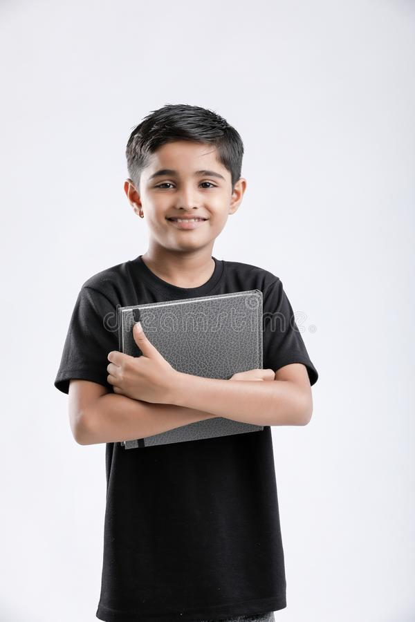little Indian / Asian boy with note book royalty free stock photos