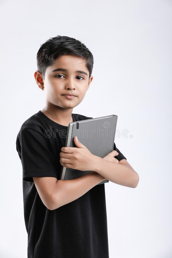 little Indian / Asian boy with note book stock photography