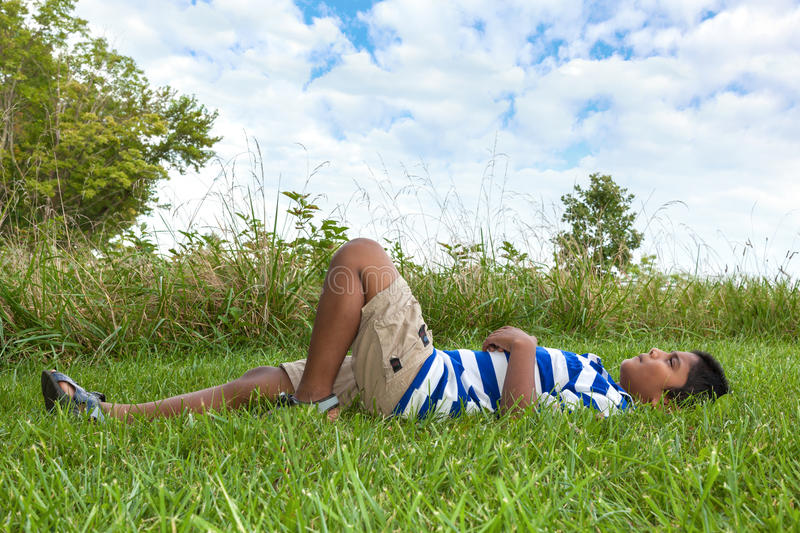 Download Little Indian Boy Looking To The Sky Stock Image - Image of adorable, people: 26556799