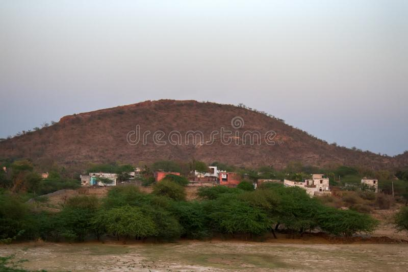 The little Indian village against the background of hill stock photos