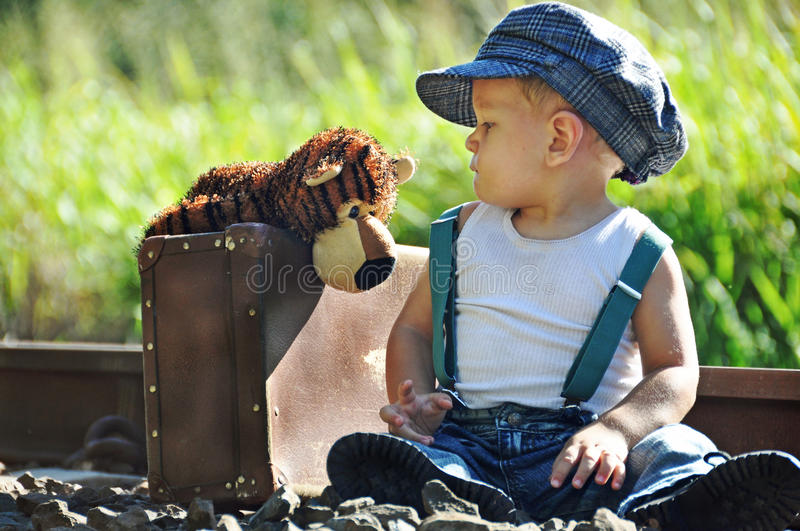 Little infant boy sharing secrets with best friend stock photography