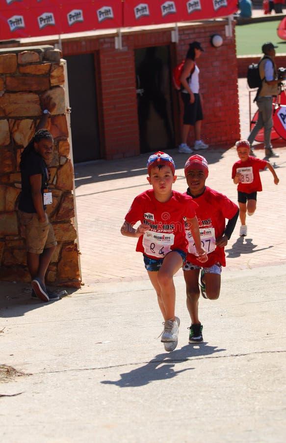 Little Ironkids athletes running stock photo