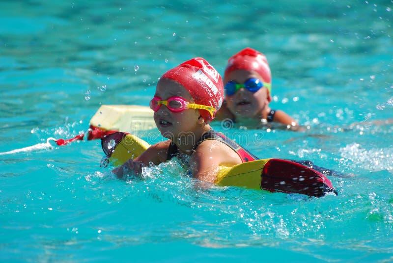 Little Ironkids girl swimming stock photos
