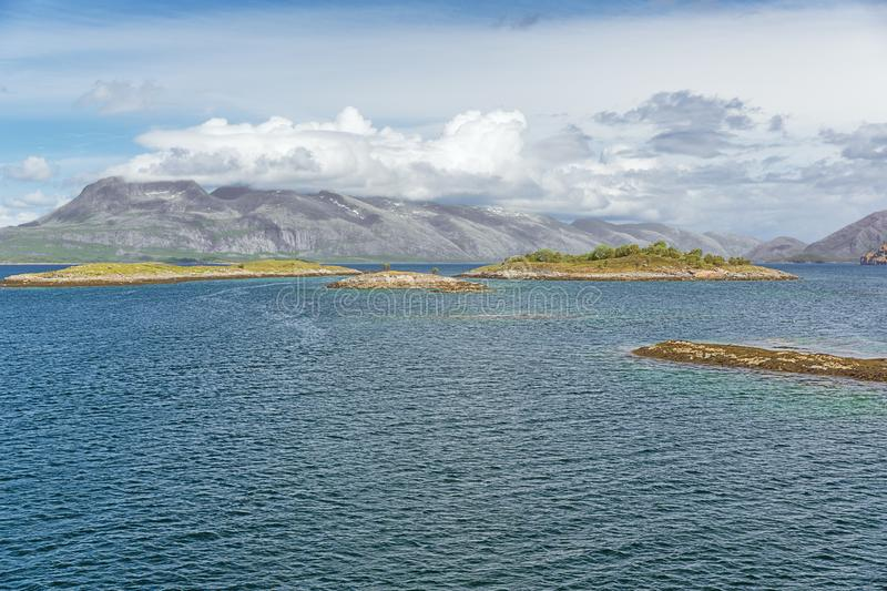 Little islets between Mindvangen and Tro. When navigating with the ferry from Forvik to Tjotta stock images