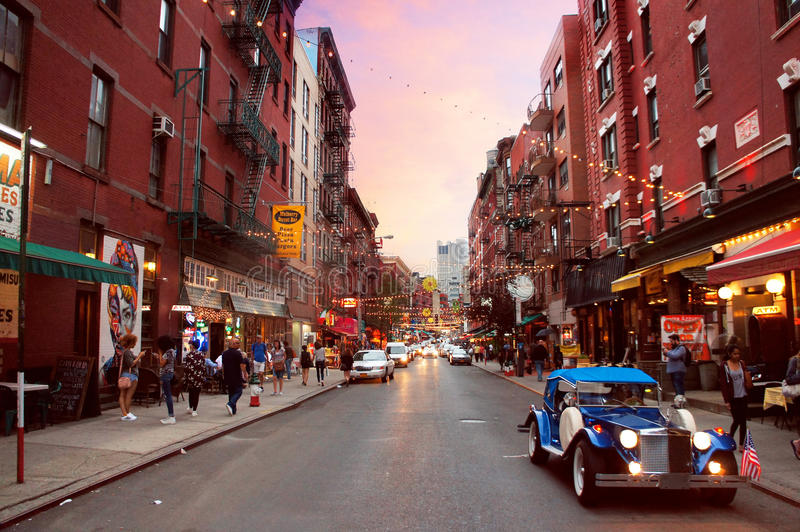 Little Italy of New York City. New York, United States - June 18, 2015: People and cars move alongside the Little Italy Mulberry street by evening in the New stock photo