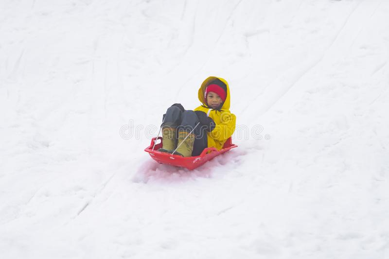 Japanese girl is sliding down the snow sled in Gala Yuzawa Ski resort royalty free stock photos
