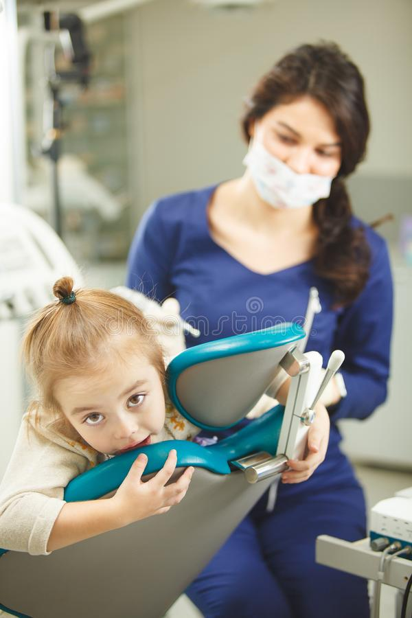 Little kid afraid of procedures in dentist office royalty free stock photos