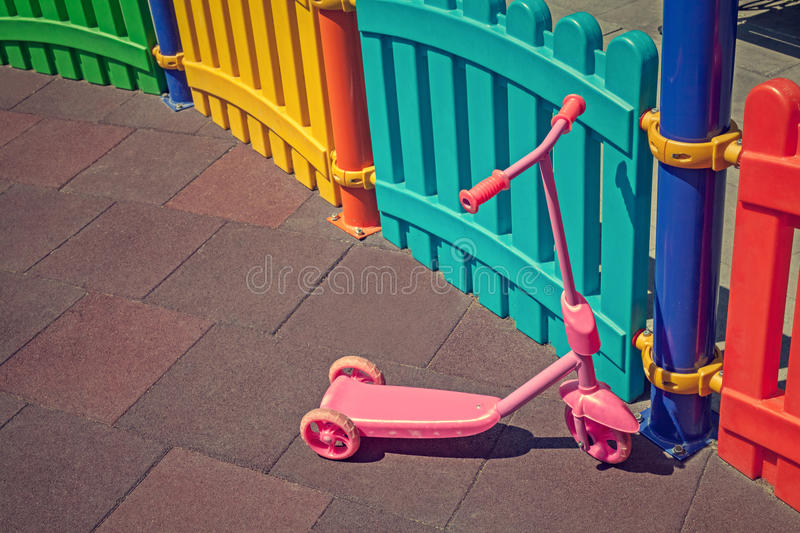Little kid bike in children playground. Closeup photo of a little kid bike in children playground royalty free stock images