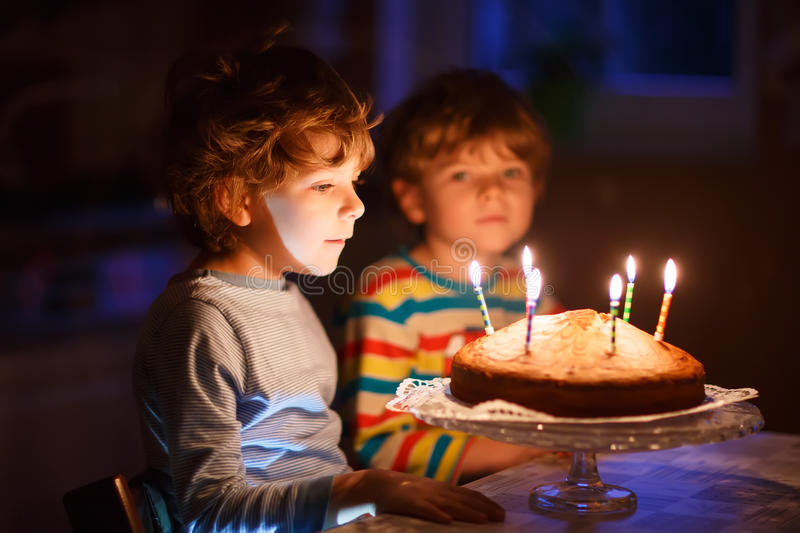 Little Kid Boy And Brother Blowing Candles On Birthday Cake Stock
