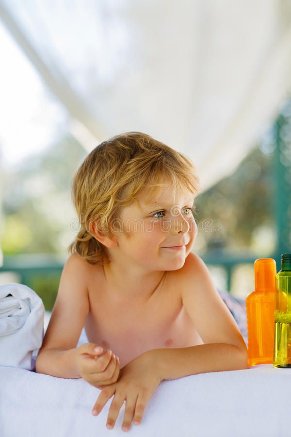Little kid boy relaxing in spa with enjoying massage royalty free stock photography