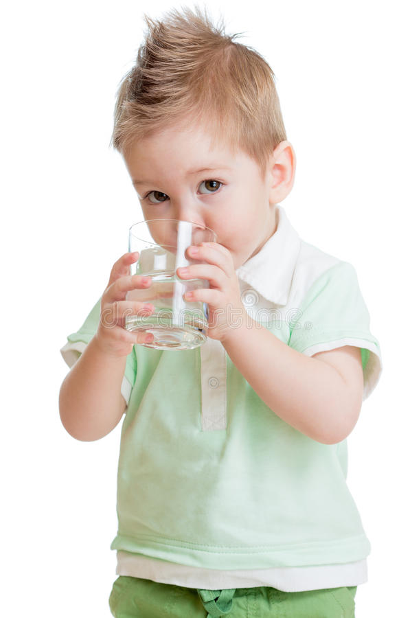 Little kid or child drinking water from glass. Isolated on white. It is a boy. Studio shot royalty free stock images