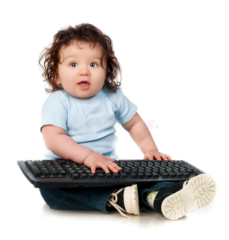 Little kid with a computer keyboard. On white stock photos
