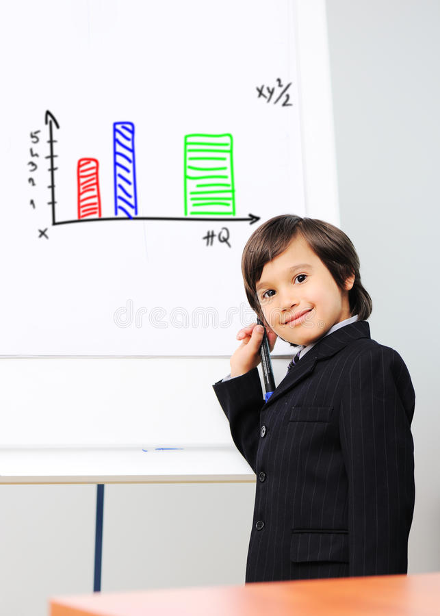Little kid drawing a diagram. On a whiteboard, future presentation stock photos