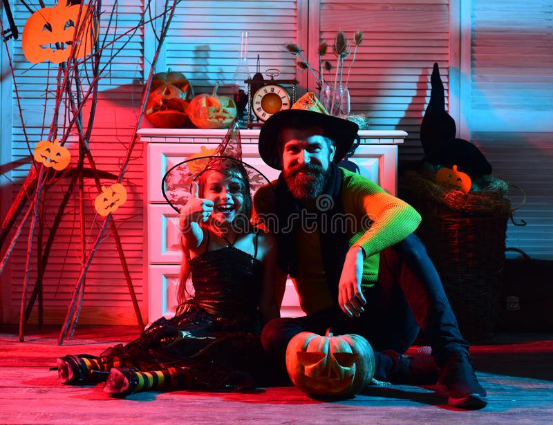 Little kid and father happy smiling on halloween. Little kid and father have fun on costume party. Happy family. Celebrate halloween. Thumbs up for halloween royalty free stock photo