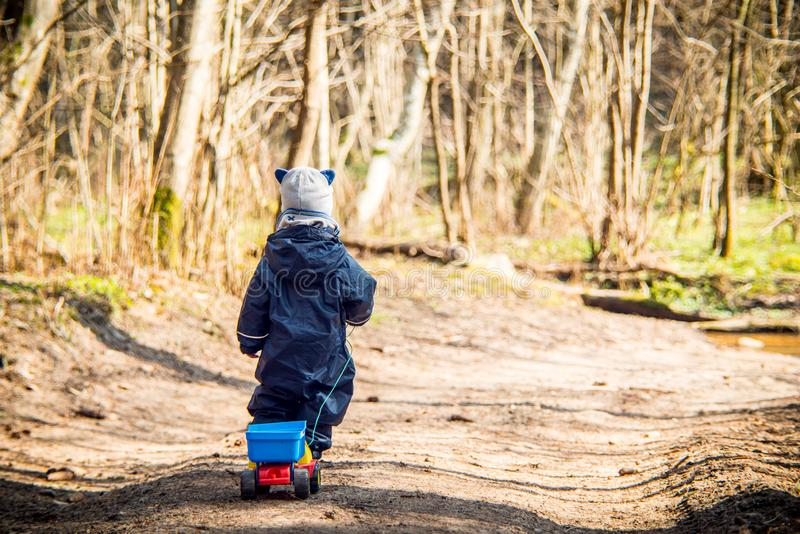 Little kid in forest playing stock images