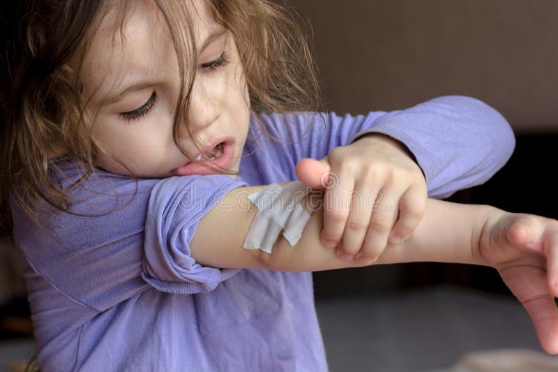 Little kid girl with band aid at elbow. Little kid girl with band aid at elbow stock image
