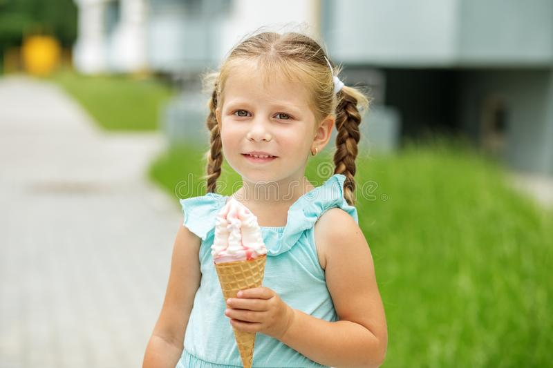 Little kid girl with ice cream. The concept of childhood, lifestyle, food, summer. Little kid girl with ice cream. The concept of childhood, lifestyle, food stock photography