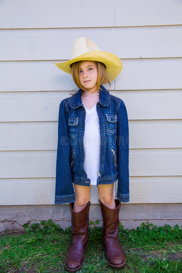 Little kid girl pretending to be a cowboy stock photography