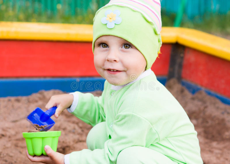 Download Little Kid Playing In A Sandbox Stock Photo - Image: 28594304