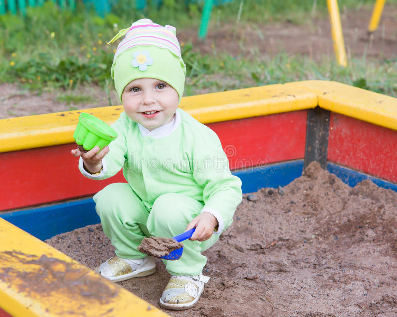 Download Little Kid Playing In A Sandbox Stock Image - Image: 28594375