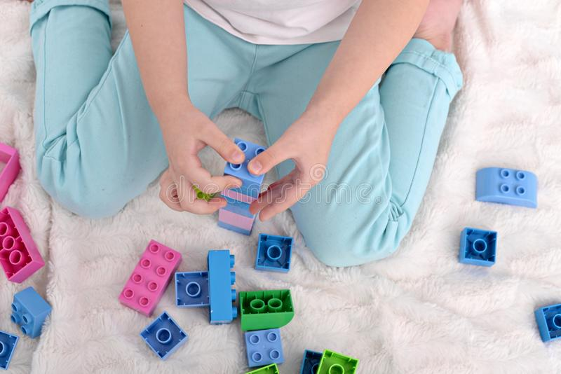 Little kid playing with toys constructor stock photography